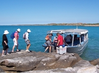 Boarding Explorer to leave Bigge Island